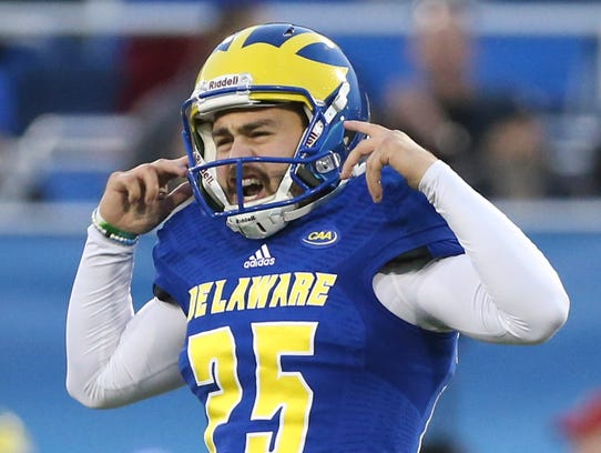 Delaware kicker Frank Raggo gestures to the Albany