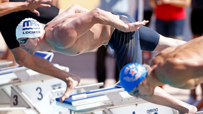 Ryan Lochte dives off the block in the 100 Meter Freestyle at the Arena Grand Prix on Thursday, April 24, 2014 at Skyline Aquatic Center in Mesa.