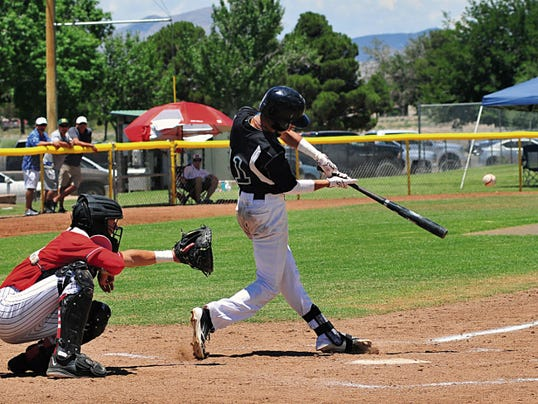 Jaime Guzman/For the Sun-News   Oñate's Fabian Reyes makes contact for a hit during Saturday's 40th Annual Bob Ogas North/South Baseball All-Star Classic at Apodaca Park.
