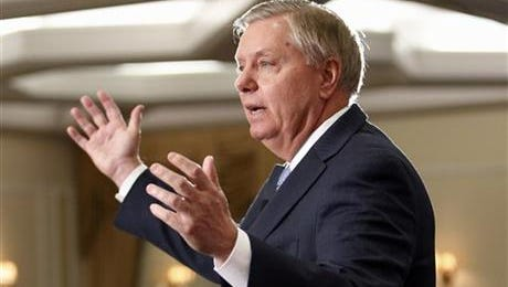 """In this April 18, 2015 file photo, Sen. Lindsey Graham, R-S.C., speaks in Nashua, N.H. Graham all but confirmed Monday that he will run for the 2016 Republican presidential nomination. In an interview on """"CBS This Morning,"""" Graham said he'd make the official announcement June 1 in his hometown of Central, South Carolina. But he also used the phrase """"I'm running,"""" explaining that he believes he would make the best commander in chief."""