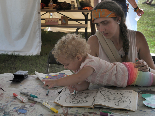 Nicole Elliott plays with her daughter, Zelda, under the Kidz Jam tent at Bonnaroo Music and Arts Festival on Friday June 12, 2015.