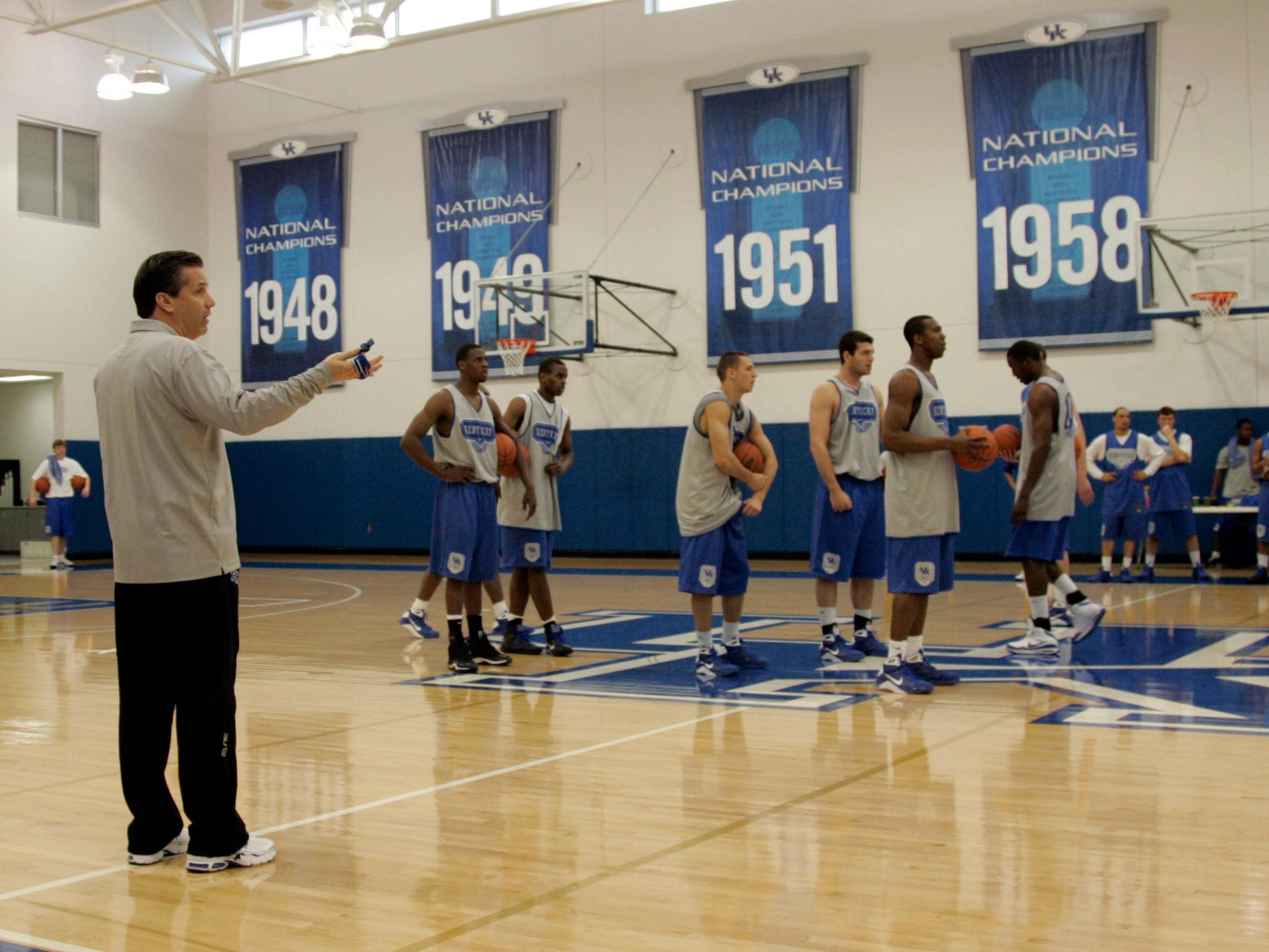 John Calipari conducts a practice shortly after taking over as Kentucky coach in 2009. He quickly recognized the need to infuse the roster with new players.