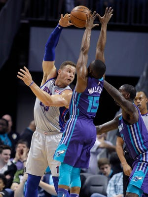 Blake Griffin gets his pass blocked and then stolen by the Hornets' Kemba Walker during the first half Sunday.