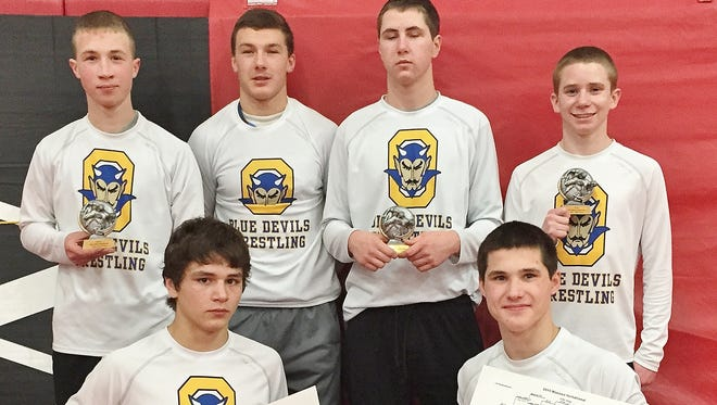 Oconto wrestlers earning first place trophies at the Manawa Invitational on Jan. 3 were, bottom, Bryan Ozak and Elton Kelsey. Top:, Tyler Wusterbarth, Hunter Michalak, Seth Reed and Aiden Wusterbarth. Reed placed third, the others earned second place.