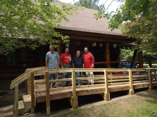 Volunteers with finished ramp