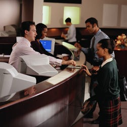 Why bank tellers won't become extinct any time soon