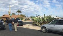 Investigators examine the crime scene after a MCSO