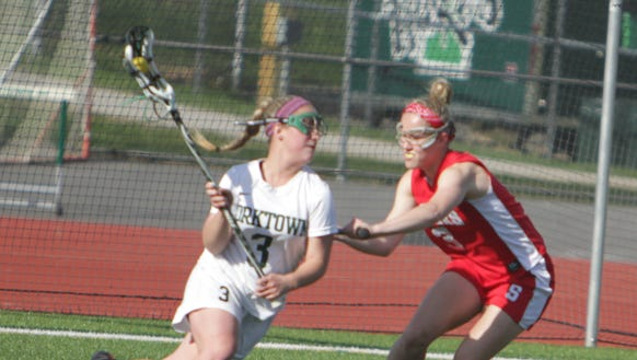 Action during a Section 1 girls lacrosse game between