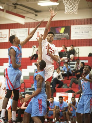 Lenape senior forward Jermane Carter goes up for two of his career-high 14 points between a host of Pennsauken defenders during the first half of Saturday's nonleague game.