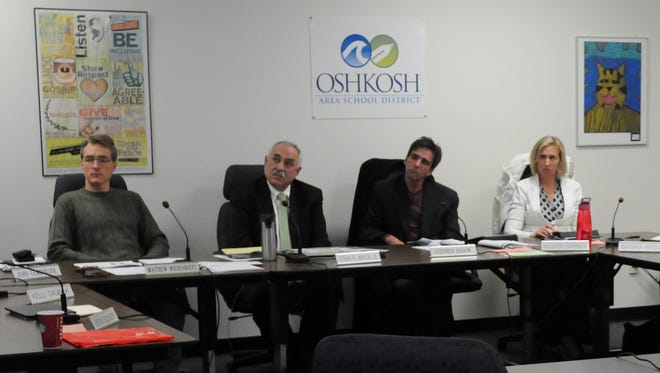 Oshkosh Area School Board President Matthew Wiedenhoeft, from left, Superintendent Stan Mack II, Vice President Steve Dedow and board member Allison Garner listen to a presentation at a board meeting.