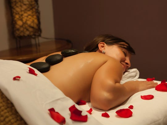 Help your heart with AVEDA Hot Stone Therapy.