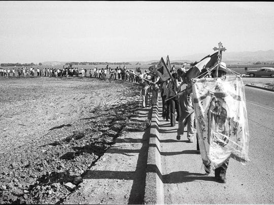 Farm workers march along a road in the Salinas Valley