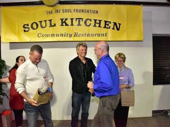 Left to right, Dolly Bonilla; Joe Perri; Jon Bon Jovi; Bob (Bart) Bortolameotti; and Denny Sullivan make the scene at the  JBJ Soul Kitchen party Tuesday, April 12 at  Middletown Sports Complex.