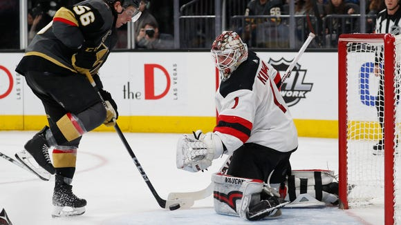 Vegas Golden Knights left wing Erik Haula scores against New Jersey Devils goaltender Keith Kinkaid during the second period of an NHL hockey game Wednesday, March 14, 2018, in Las Vegas. (AP Photo/John Locher)