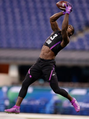 Alabama defensive back Tony Brown runs a drill at the NFL football scouting combine in Indianapolis, Monday, March 5, 2018. (AP Photo/Michael Conroy)