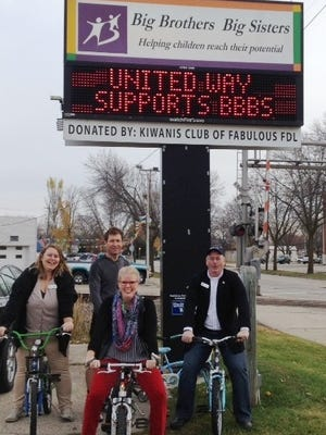 Bikes were donated to Big Brothers big Sisters recently by Habitat for Humanity and Attitude Sports. Pictured are, from left: Julie Woznick, Charter Communications, Habitat for Humanity president; Dave Haase, Attitude Sports; Tammy Young, executive director of Big Brothers Big Sisters; Paul Osterholm, executive director of Habitat for Humanity.