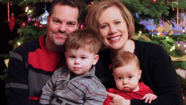 Dan and Kelli Gassman on Dec. 13, 2014, with their children: Trevor, 2, and Aubrey, 9 months.  The children were born to Kelly from donated embryos.
