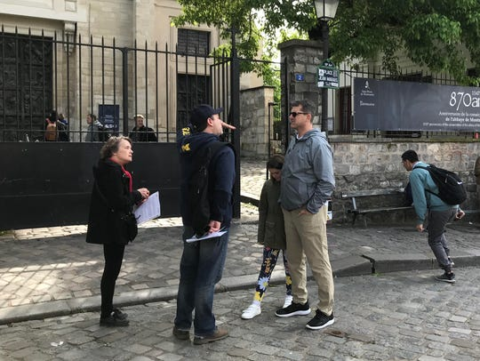 Michigan football coach Jim Harbaugh chats with a U-M alumnus atop Montmartre in Paris on Tuesday, May 1, 2018.