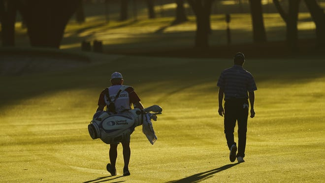 Ryan Palmer walks with his caddie down the first fairway during the first round of the Charles Schwab Challenge at the Colonial Country Club in Fort Worth, Texas on Thursday.