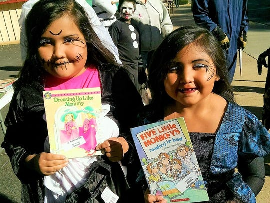 Two little readers our trick or treating were happy to take home some books from the table of choices presented by members of Ruidoso Altrusa.