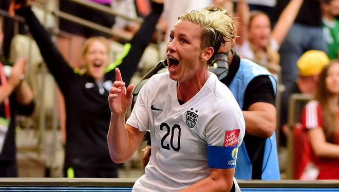 United States forward Abby Wambach (20) celebrates after scoring a goal against Nigeria during the first half in a Group D soccer match Tuesday in Vancouver.