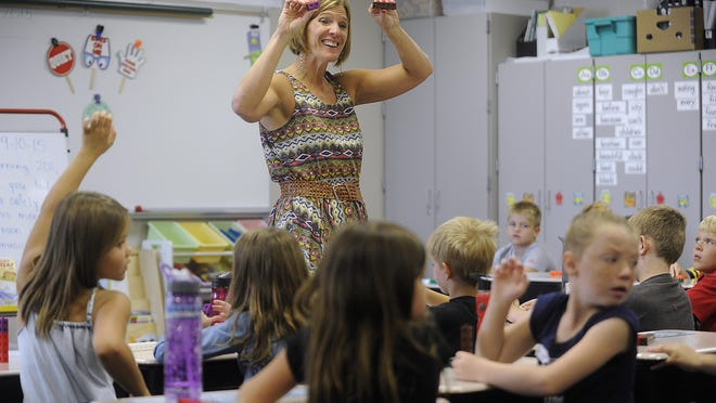 Gail Flaa teaches with math manipulatives during her second grade class at Discovery Elementary School on Thursday in Sioux Falls. Sioux Falls School District enrollment increased by 282 students this year.