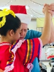 Mimbres Memorial Nursing Home resident Sidney Mintzer trips the light fantastic with Red Mountain Middle School folklorico dancer Crystal Sanchez.
