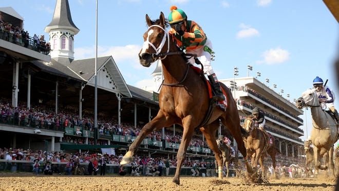 Lovely Maria, with Kerwin D. Clark wins the Kentucky Oaks.