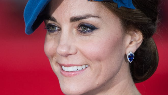 Duchess Kate of Cambridge steps out with a smile as she arrives in Victoria, B.C.