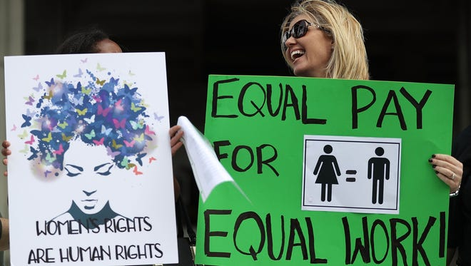 Elana Goodman joins with other protesters calling for women to be paid equally to their male co-workers on March 14, 2017 in Fort Lauderdale, Fla. The protest was held as the legislation in the state of Florida looks at passing the Helen Gordon Davis fair pay protection act that would strengthen state laws in terms of equal pay.