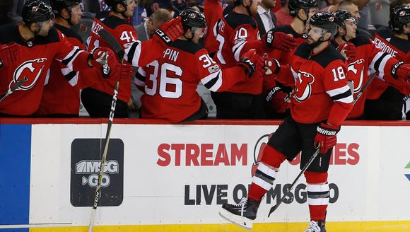 New Jersey Devils right wing Drew Stafford (18) celebrates