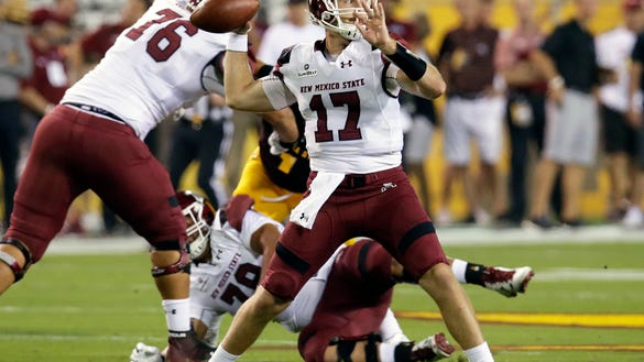 New Mexico State quarterback Tyler Rogers (17) throws a screen pass against Arizona State during the first half during an NCAA college football game, Thursday, Aug. 31, 2017, in Tempe, Ariz. (AP Photo/Rick Scuteri)