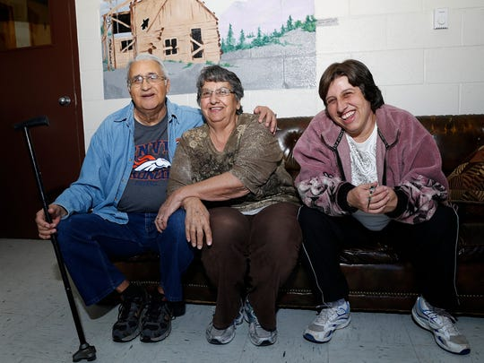 From left, Edward and Loretta Lawrence pose for a photo on Wednesday, along with their daughter, Stephanie, at the Aztec Senior-Community Center.