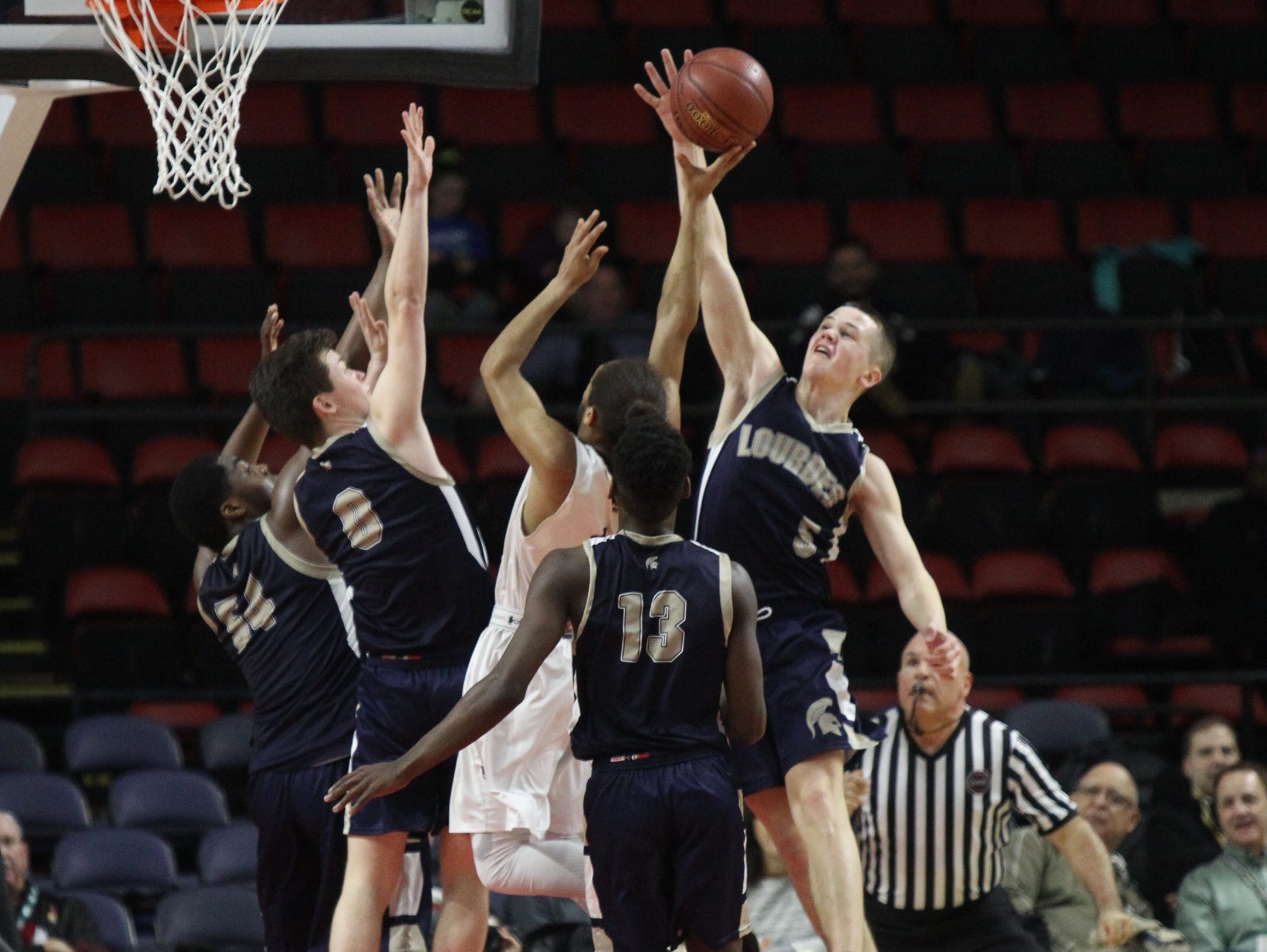 Lourdes' Aiden Hildebrand (5) blocks a shot during their 70-67 win over Southampton in the NYSPHSAA boys Class A semifinal basketball game at Floyd L. Maines Veterans Memorial Arena in Binghamton on Saturday, March 18, 2017.