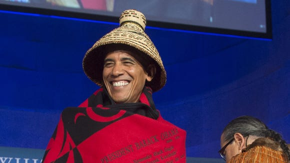 President Obama wears a traditional blanket and hat