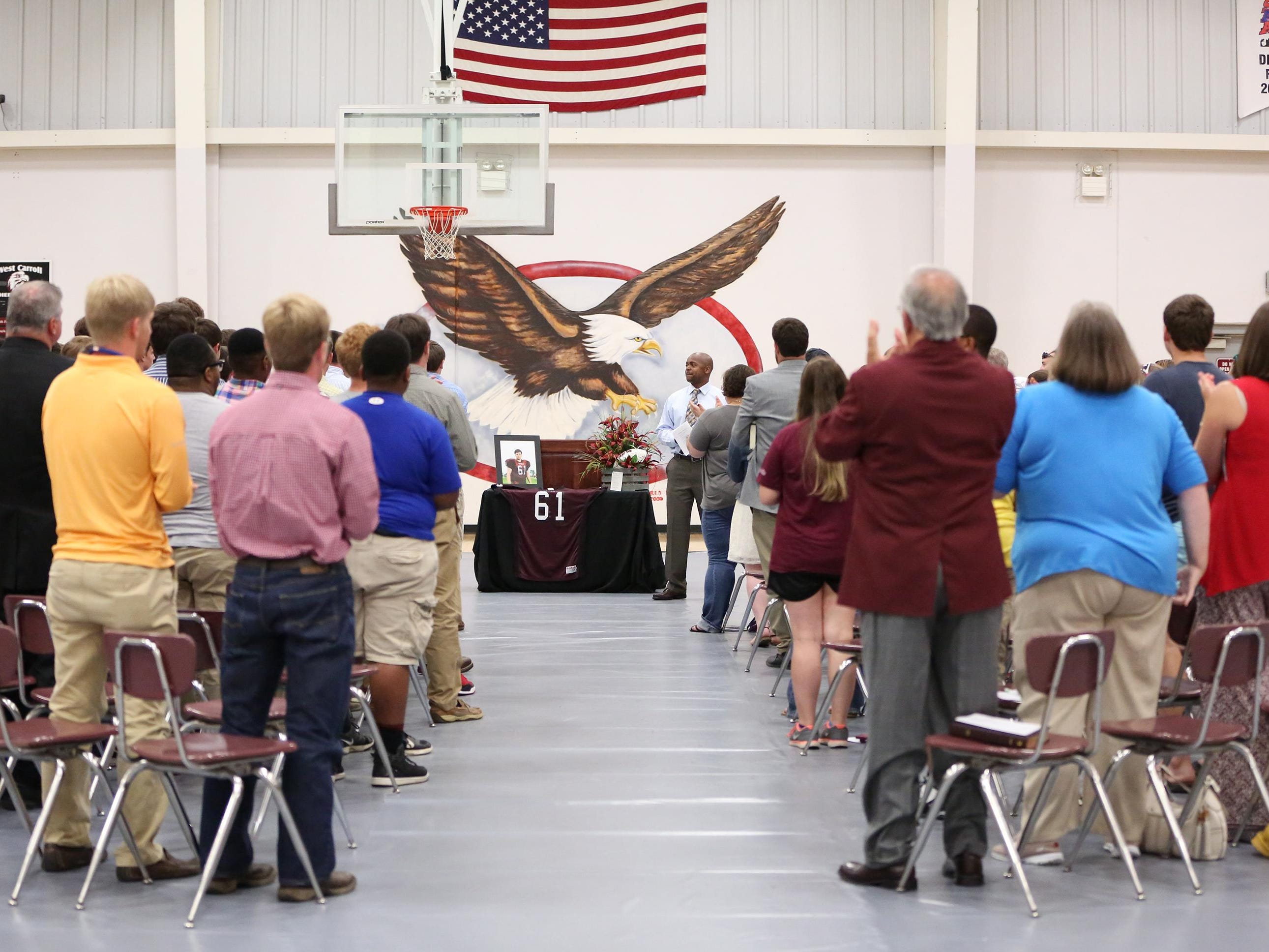 Dexter Williams welcomed everyone to the memorial/celebration service of Austin Blake Ray at West Carroll High School and led them in applause for the celebration of the young man's life.