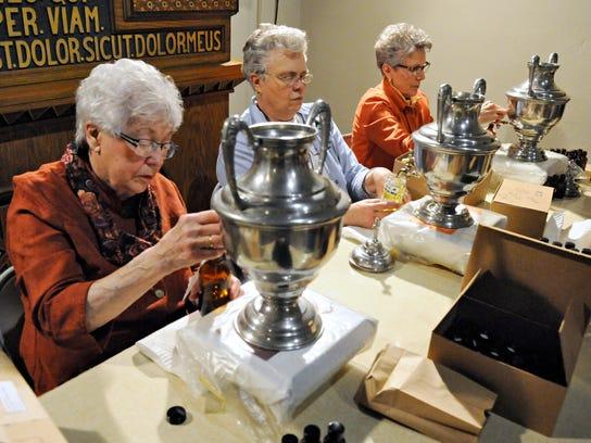 Lorraine Curto, Ellen Palmer and Jan Hoelscher bottle