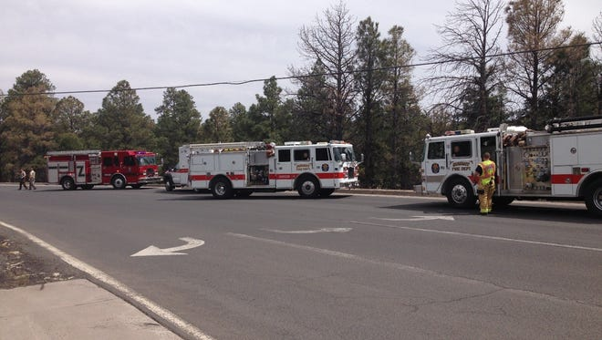 Firefighters battle on Saturday, May 23, 2015, a 50-plus acre wildfire in northern Arizona near Flagstaff.
