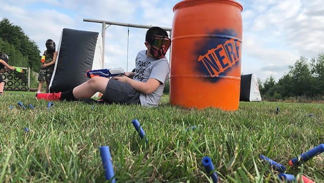 """Young members of Fitness Concepts in Gardner participate in a """"Nerf Battle,"""" one of several new outdoor programs that owner Anthony Cali said the club might never have introduced had it not been for the COVID-19 shutdown."""