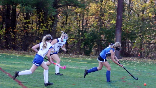 Murdock junior Chloe St. Peter breaks free from a pair of Narragansett defenders and sprints toward the cage on her way to scoring for the visiting Blue Devils during Wednesday afternoon's game at Arthur L. Stuart Memorial Field in Baldwinville.