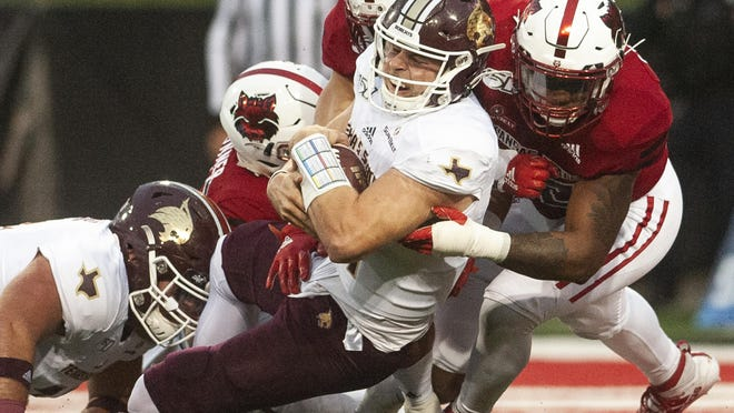 Texas State quarterback Tyler Vitt, shown getting swarmed by Arkansas State defenders during their game last year in Jonesboro, Ark., took several hard hits in last week's double-overtime loss to UTSA, Bobcats coach Jake Spavital said.