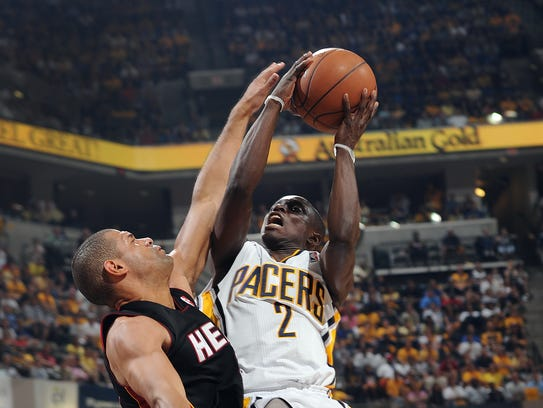 Indiana Pacers Darren Collison,right, is fouled as