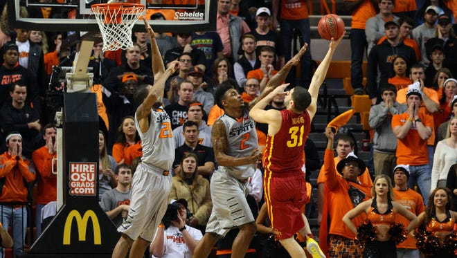 Iowa State Cyclones forward Georges Niang (31) shoots over Oklahoma State Cowboys guard/forward Le'Bryan Nash (2) and forward/center Michael Cobbins (20) to seal the win during the second half at Gallagher-Iba Arena. Iowa State won 70-65.