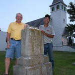 Cousins Jim Hyde, left, and Kent Arnaud stand by the grave of their great-great-grandfather Paul F. Reynaud, who died in 1905. He was one of the earliest members of the Waldensian Presbyterian Church, near Monnett.