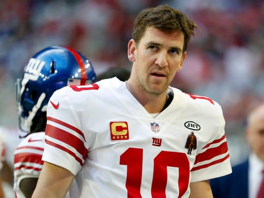 New York Giants quarterback Eli Manning (10) stands on the sidelines during the second half of an NFL football game agains the Arizona Cardinals, Sunday, Dec. 24, 2017, in Glendale, Ariz. (AP Photo/Rick Scuteri)