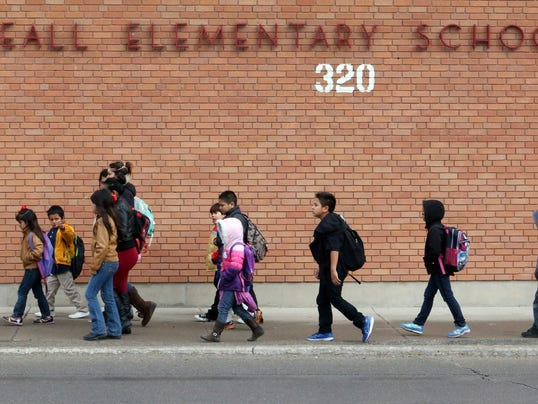 Beall Elementary School student leave the campus at the end of Friday's school day at 320 N. Piedras.