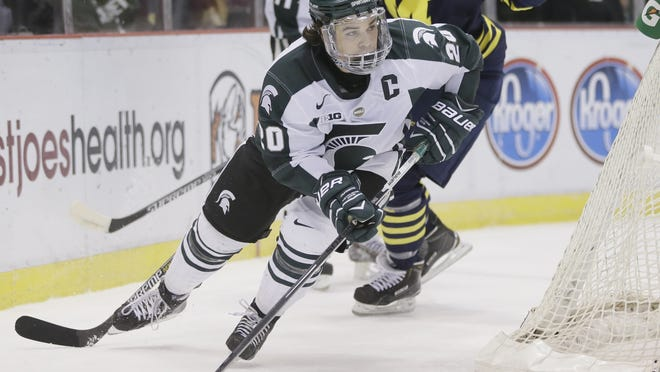 Michigan State forward Michael Ferrantino controls the puck during the first period of an NCAA college hockey game against Michigan Friday.