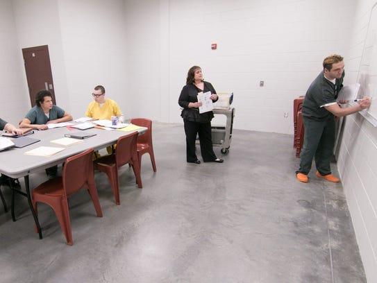 Livingston County Jail educator Laura Ness, center