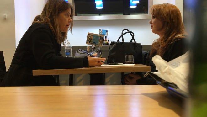 Washington Post reporter Stephanie McCrummen, left, interviews Jaime T. Phillips at a Greek restaurant in Alexandria, Va., on Wednesday.