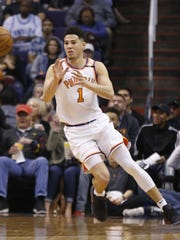 Suns star Devin Booker catches a pass with the help